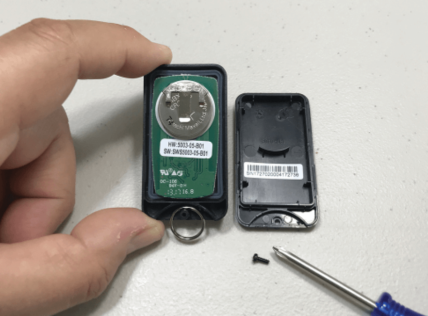 Keychain alarm remote in Florida with cover off